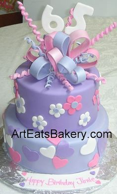 Two tier purple, pink and white fondant hearts and flowers 65th birthday cake with sugar bow by arteatsbakery, via Flickr: