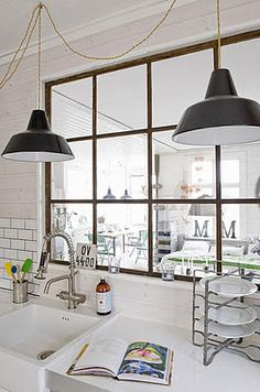 If there is a wall in the kitchen that I really hate but can't take it out, I would totally put in a mirrored window like this.