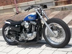 Blue & White Evo Sportster swingarm custom with short cobra seat by Gravel Crew
