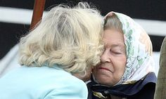 Mw'aam! The Queen makes a meal of kiss with Camilla