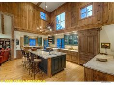 12315 Snowpeak Way, Truckee, CA 96161 — A beautiful golf course home designed by the Evolution Design Team. Sophisticated rustic elegance combined with old world charm, this home is ideal as a mountain getaway or full time living. Custom iron, stone and wood decor throughout, no attention to detail has been spared! A gourmet kitchen with top of the line appliances, fossilized limestone & granite counters for the discerning chef. Other features include reclaimed barnwood, cypress flooring…
