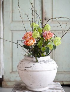 simple floral arrangement in coral and spring green tones