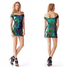 Guess green black blue sequin dress size 8 Size 8  Iridescent sequins and a sexy off-the-shoulder design make this dress an instant show-stopper. Perfect for holiday parties and glamorous nights out, it's an unforgettable special occasion piece Guess Dresses