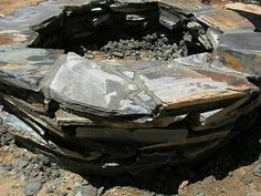 Backyard Slate Firepit - leave out the lava rock and glass.  Leave some gaps between slate pieces ??
