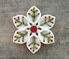Christmas flower (How Do It Info). White felt with green and red embroidery.