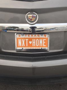 Ann Banos wins the prize with this orange NextHome license plate!