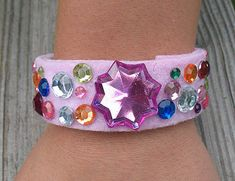 Cardboard Tube Bracelet | Crafts by Amanda - Thinking about Adrian's recent interest in jewelry.  Maybe make a Prince or Wizard bracelet?