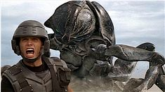 There's been quite a bit of revisionist history surrounding Dutch director Paul Verhoeven's 1997 film Starship Troopers, a movie largely savaged by critics of the time but currently sitting at 63 percent on Rotten Tomatoes due to a conspicuous number of reviews from about a decade after it came out that recognize it as a pointed satire.