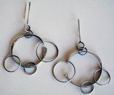 Earrings   Art Smith.  Sterling silver.  ca. 1950s.  $ 7500.