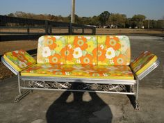 We had one in the backyard with blue cushions. (Mid Century Modern Aluminum Patio Glider w Cushions)