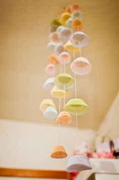 Cupcake liner moblie, could be cute to decorate the cupcake table with something like this....candyland party?