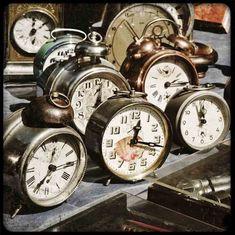 Vintage clock centerpieces for NYE wedding!