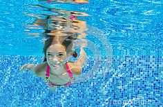 Happy active underwater child swims and dives in pool by Jaysi, via Dreamstime