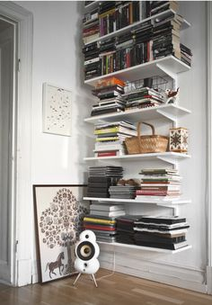 If I don't find some appropriate book cases for cheap soon, I might have to resort to this- which isn't so bad, after all!