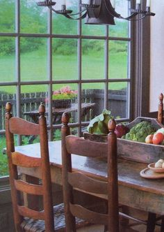 Beautiful: the land outside, the large window, the rustic table, and fresh food from the garden. One day I will have this.