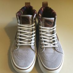 Vans Sk8-Hi MTE's Grey/Khaki suede upper, rubber boot tread sole, pre-treated with scotch guard which makes them water resistant. There is a heat retention layer in between the sole and sock liner which regulates body temp. Only worn a few times. Women's size 5.5 Vans Shoes Sneakers