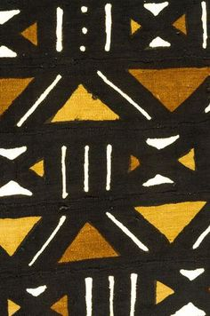 """Bogolanfini, which translates to """"mudcloth"""", is a hand-dyed cotton textile crafted predominantly by the Bamana people of Mali. Using fermented mud and a solution of boiled plant leaves, artisans create meaningful designs on the field, which is pieced together from long strips of woven cotton. These large pieces of bogolanfini make very dramatic throws, wall hangings or picnic blankets."""