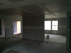 Dining looking towards Family Roon with Sheetrock in tape & float phase