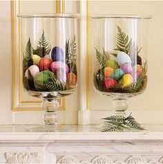Dyed Easter eggs in apothecary jars with ferns
