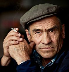 Elderly Drivers: by Zac Murfet on Prezi. Elderly male, old guy, cap, cigarette, hands, wrinckles, lines of life, powerful face, intense eyes, strong, thoughtful, portrait