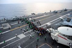 SOUTH CHINA SEA (Oct. 25, 2013) Sailors participate in a foreign object damage (FOD) walk down on the flight deck of the U.S. Navy's forward-deployed aircraft carrier USS George Washington (CVN 73). (U.S. Navy photo by Mass Communication Specialist 3rd Class Peter Burghart/Released) Digital