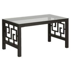 """Glass-topped coffee table in bronze with Greek key latticework.    Product: Coffee tableConstruction Material: Steel and glassColor: BronzeDimensions: 18"""" H x 42"""" W x 24"""" D"""