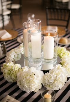 wedding table decor with candles vases with floating candles embellished with white 1170