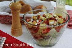BLT Salad~ A layered salad made with thick cut bacon, crunchy iceberg lettuce, summer ripened fresh red tomatoes and substantial and chunky croutons finished with a homemade Ranch dressing.
