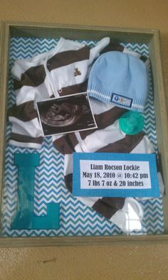 coming home outfit in a shadow box along with paci and an ultrasound picture. :) awesome idea..have to remember this for when i have babies like 8 years from now lol