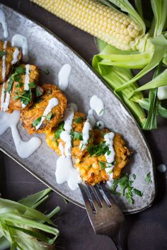 Corn Fritters with Jalapeño and cilantro with a cilantro lime cream | www.feastingathome.com
