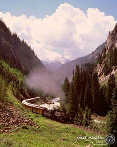 The famous Durango & Silverton Narrow Gauge Railroad snakes its way through the San Juan Mountains on its way to Silverton, Colorado.