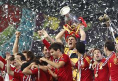 Spain goalkeeper Iker Casillas lifts the trophy after the Euro 2012 soccer championship final between Spain and Italy in Kiev, Ukraine, Sunday, July Spain won the match (AP Photo/Gregorio Borgia) Spain National Football Team, Euro Championship, Euro 2012, European Soccer, Fc Chelsea, European Championships, Goalkeeper, Finals, Social Networks