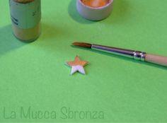 http://lamuccasbronza.blogspot.com  stellina dipinta in oro