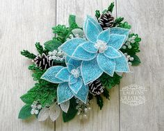 French Beaded Poinsettia Swag in Icy Blue and White with beaded fir branches, berries and pine cones