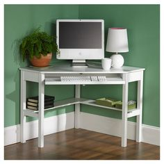Features:  -Spacious keyboard tray.  -Convenient storage shelf.  -Cord management.  -Constructed of solid birch and medium density fiberboard.  -Painted White Finish.  -Wire hole slot included: Yes.