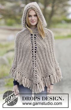 "Knitted DROPS poncho with hood and fringes, worked top down in ""Polaris"". Free Pattern"