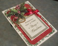 This beautiful card measures 4 1/2 x 6 1/4 and was made using PTI & Anna Griffin card stocks, three dimensional, die-cut stickers & ribbon. The red layer is an embossed, velvet layer, so pretty! The holly is adorned with dazzling details glitter. The front phrase is a gold embossed metallic panel.    Inside: MAY YOU HAVE THE SPIRIT OF CHRISTMAS WHICH IS PEACE, THE GLADNESS OF CHRISTMAS WHICH IS HOPE, THE HEART OF CHRISTMAS WHICH IS LOVE.    NOTE: This is a finished card, both inside and…