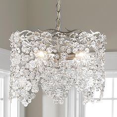 "Glass Lace Drum Chandelier When the lights are on this Glass Lace Drum Chandelier glows beautifully as the light passes through the delicately detailed glass flowers and bounce off the Gold or Silver Leaf finish. 3' of chain and wire and 4 7/8"" canopy included. (12""Hx17""W)"