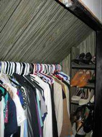 Q: My master bedroom closet is very awkward and I am looking for some good tips/solutions to help my organization issues. I have a 1½ story home and the master bedroom ceiling is slanted. This means that unfortunately my closet is slanted as well. It is my only closet and it's driving me nuts not having shelving! Does anyone have any ideas for storage solutions in such an awkward space? Sent by Kristin