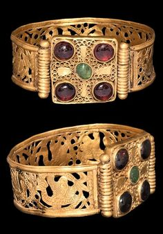 Byzantine Gold Emerald Jewelled Bracelet, Century ADA flat-section gold band with median openwork section depicting facing pairs of doves flanking a vessel with foliage; the center a later substantial square frame with scrolled wire fill,. Byzantine Gold, Byzantine Jewelry, Medieval Jewelry, Viking Jewelry, Ancient Jewelry, Antique Jewelry, Vintage Jewelry, Wiccan Jewelry, Antique Bracelets