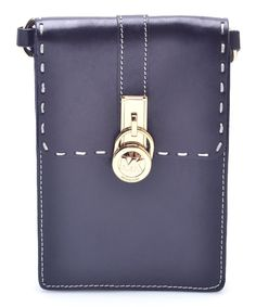 This essential carrying fanny pack boasts supple leather and gold locket hardware for a chic finish. The petite design and adjustable belt strap ensure on-the-go functionality.Bag: 5'' W x 7'' H x 1'' DLeatherSnap closureAdjustable strapImported