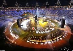 2012 Olympics Opening Ceremony: The stadium is filled with dancers on giant beds