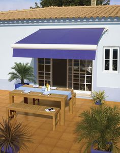 Bright colour in an awning adds personality and add shade for patio garden.  #awning #luxaflex #garden #lblue