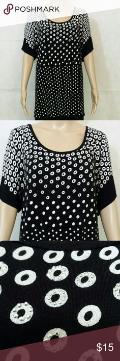 """Ladies Short Sleeve Top/Blouse This is a short sleeve top black background with white circles and polka dots on it decorated with random small silver decorations on the circles at the upper part of the front of the garment. It measures approximately 26 inches from underarm to underarm. It runs a little large. As seen in picture #4, there is a 6""""  wide sheer panel running along the back hem. Fabric is a polyester cotton blend. B.L.E.U. Tops Blouses"""