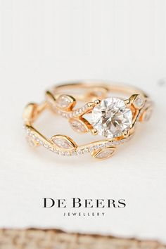Discover our delicate and elegant Adonis Rose engagement ring and matching wedding bands.