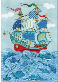 Riolis Sailboat Luck - Cross Stitch Kit. Cross stitch kit featuring a sailing ship on the ocean, with fish and a shark. This cross stitch kit includes 14 count