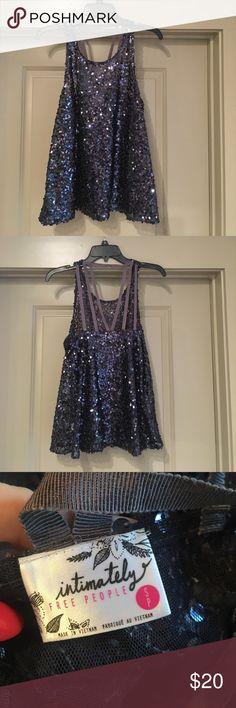 Free People sequined top Free People sequin top with strap design on back. Never worn. Dark blue/black color. Free People Tops