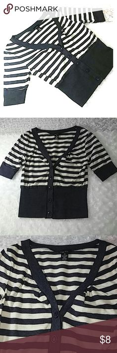 """Rue 21 Fitted Waist Striped Mini Crop Tops Reasonable offers always welcome on items over $15! No trades. Don't let this ship lonely, bundle and $ave!  Gently previously loved condition. Trendy button down, v- neck, fitted waist, crop tops. Light cream/ off white and navy blue stripes, plus an all black option. Fitted knit 1/4 sleeves, waists and collar accents. Very light amount of pilling. Stretch fabric. Bust 14.5"""" flat, 18.5"""" total length, about 5"""" inseam. 95% cotton, 5% spandex…"""