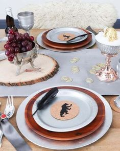 How to set the perfect Game of Thrones themed table, with DIY decor, food and drink ideas and more. Perfect for a 10th Anniversary Game of Thrones Watch Party! Get details and more party inspiration now at fernandmaple.com.