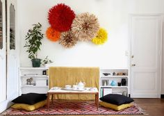 SELENCY : object / juju hat / behind the couch / salon / living room / on the wall / red / yellow / beige